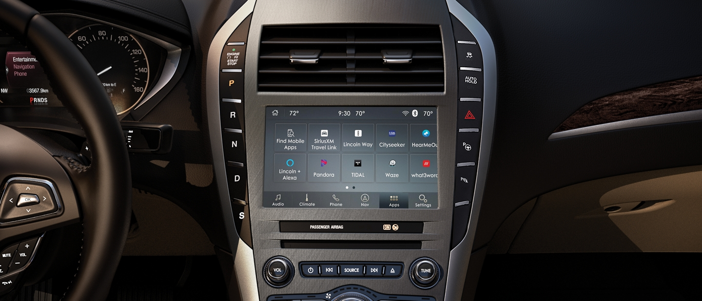 A SYNC 3 welcome screen is seen in the center console of the 2020 Lincoln M K Z