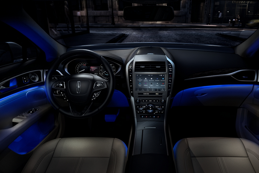The interior cabin of the 2020 Lincoln M K Z glows with a soft amber ambient light