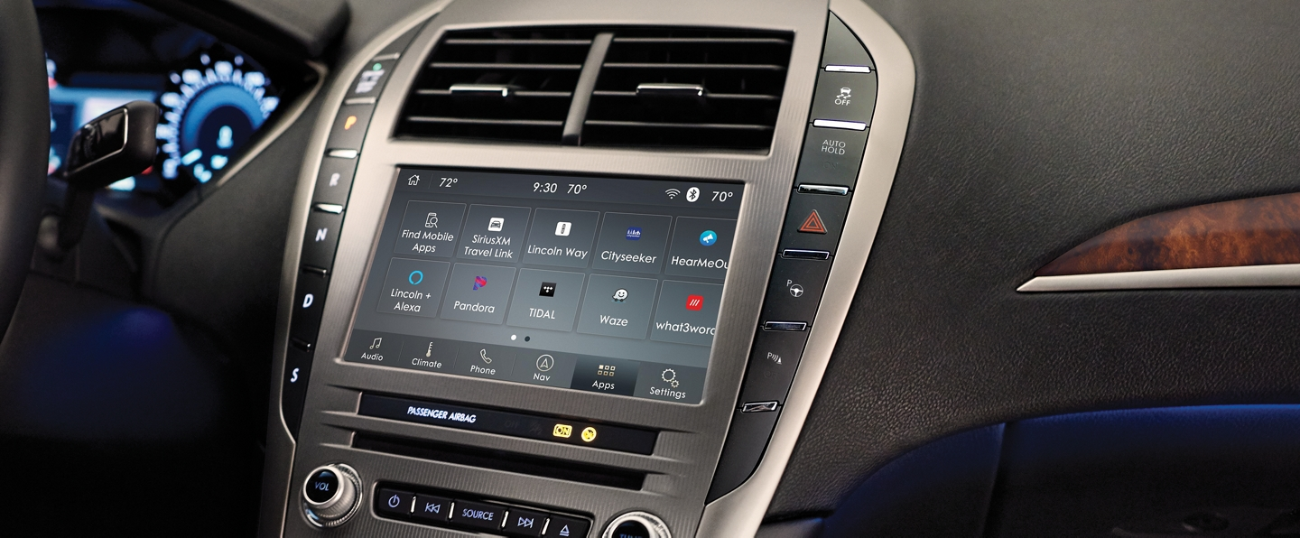 The center touchscreen of a 2020 Lincoln M K Z displays various apps via the sync 3 app link