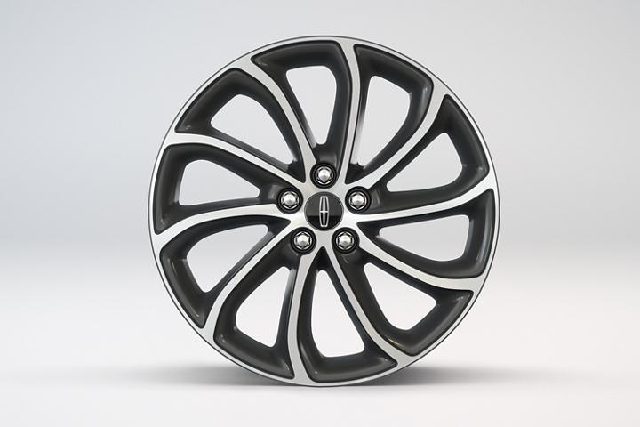 """Se muestran las ruedas de aleación con frente maquinado de 19"""" con tapas pintadas en magnético"""