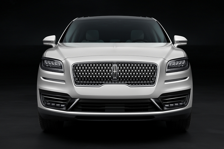 The front fascia and signature grille of a Lincoln Black Label Nautilus are shown in the Chalet theme
