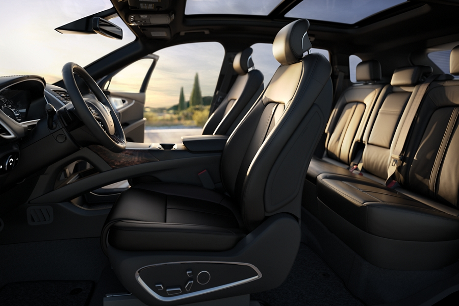 Sunlight is shown filtering through the windshield highlighting the driver and front passengers Ultra Comfort seats
