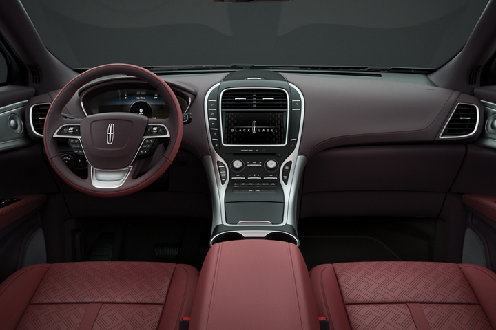 The center console and front seats of a Lincoln Black Label Nautilus are shown in the Gala interior theme