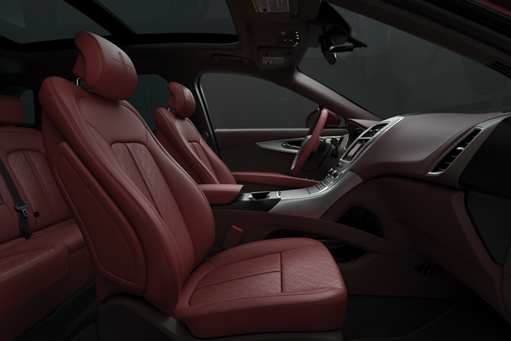 The front passenger and drivers seats of a Lincoln Black Label Nautilus are shown in the gala theme from the side