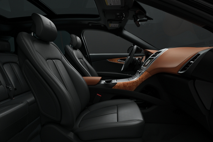 A side view highlights the front passenger and drivers seats in a Lincoln Black Label Nautilus in the Thoroughbred theme