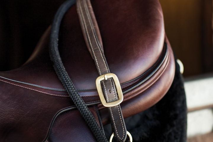 A saddle is shown to express the inspiration and warmth of the Thoroughbred theme