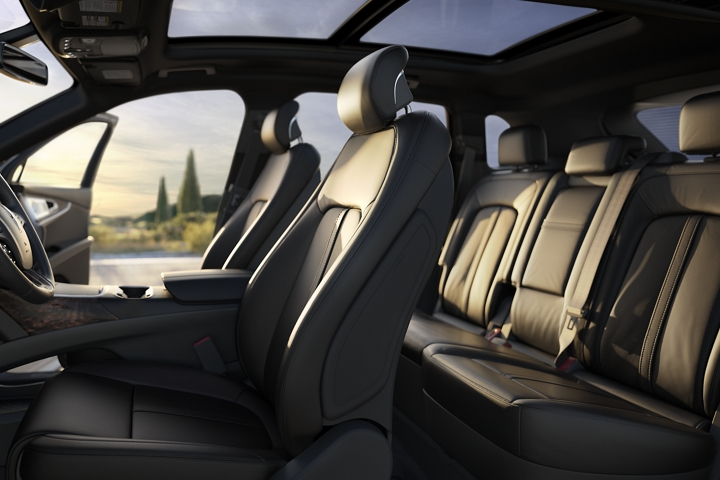 Available leather trimmed Ultra Comfort front seats and second row seats are shown in the Ebony interior color