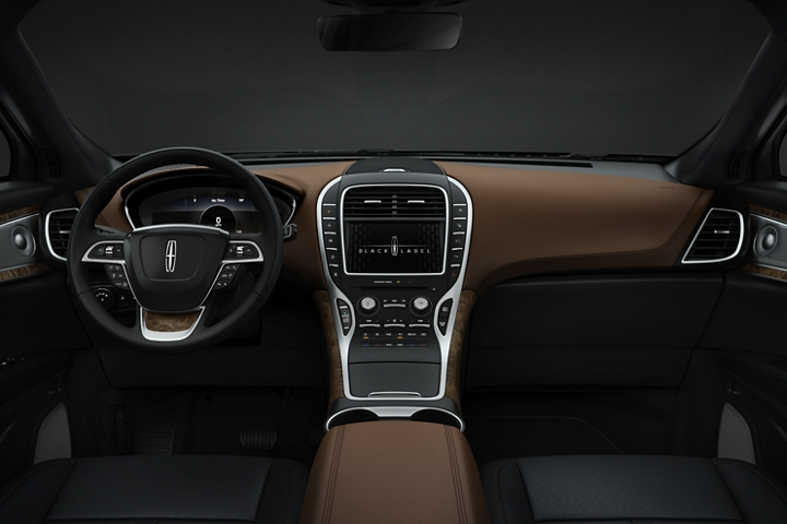 The driver and front passenger seats of a 2020 Lincoln Black Label Nautilus in the Thoroughbred theme are shown from the second row looking forward