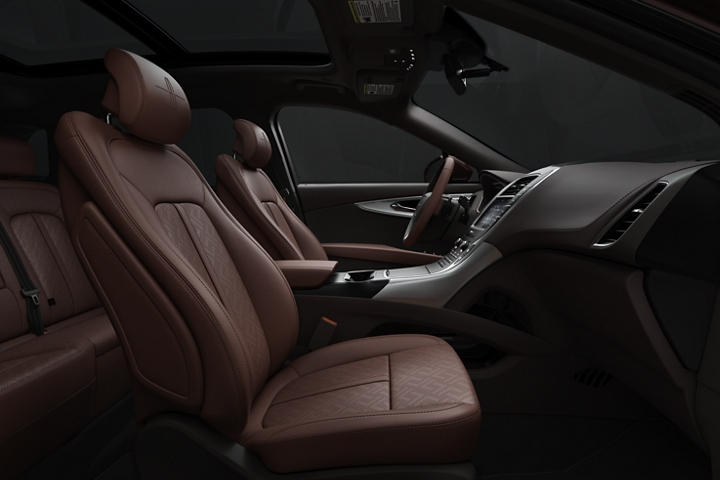 The front passenger and drivers seats of a 2020 Lincoln Black Label Nautilus are shown in the gala theme from the side