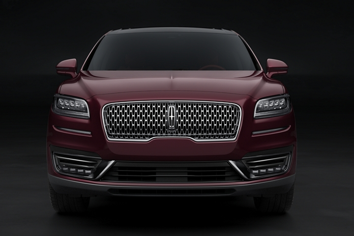 The grille and front fascia of a 2020 Lincoln Black Label Nautilus shines against the Burgundy Velvet exterior color
