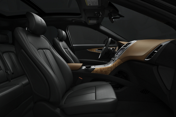A side view highlights the front passenger and drivers seats in a 2020 Lincoln Black Label Nautilus in the Thoroughbred theme