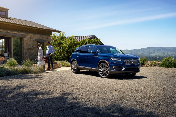 A 2020 Lincoln Nautilus is shown parked at the entrance of a weekend getaway retreat