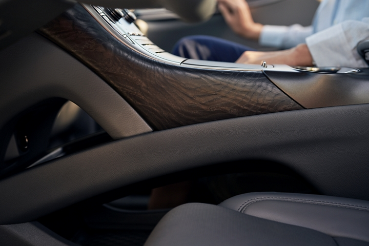 Available real open pore wood is shown adorning the side of the center console