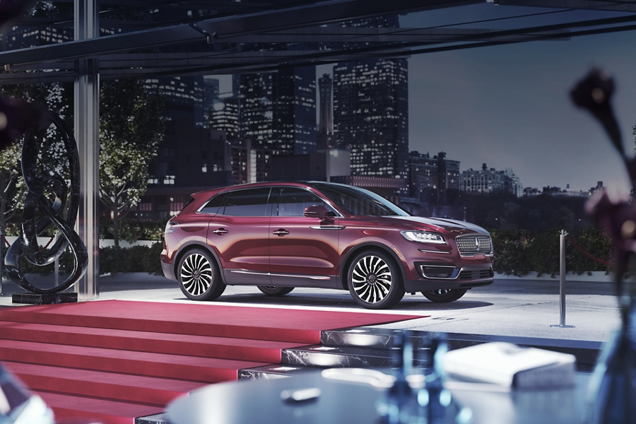 A 2020 Lincoln Nautilus shown in the Lincoln Black Label Gala theme is parked near the entrance of a special event