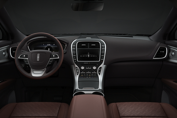 The center console and front seats of a 2020 Lincoln Black Label Nautilus are shown in the Gala interior theme