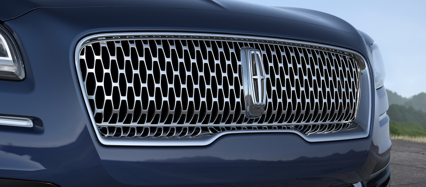 The Lincoln Star logo is shown on the grille of a 2020 Lincoln Nautilus