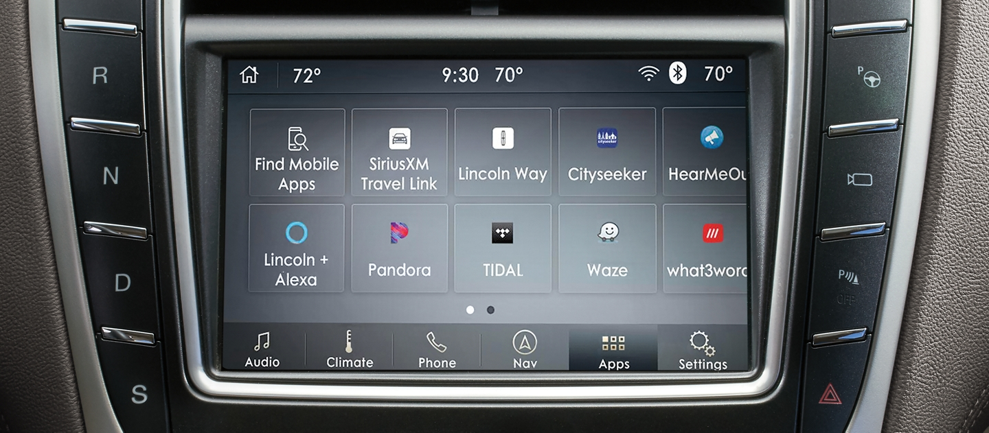 The center touch screen of a 2020 Lincoln Nautilus is shown with clickable hotspots which lead to more information