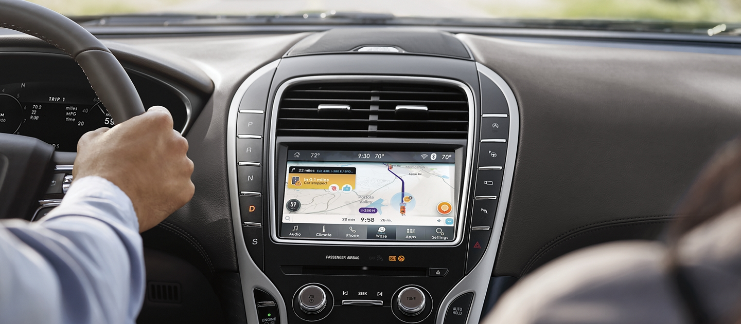 The Waze app screen is shown in the center console of a 2020 Lincoln Nautilus