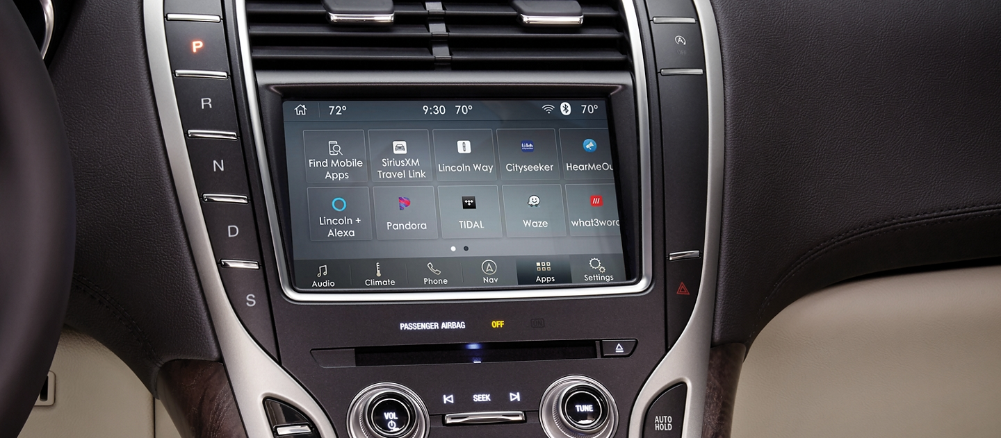 The digital interface of the touchscreen is shown located in the center console