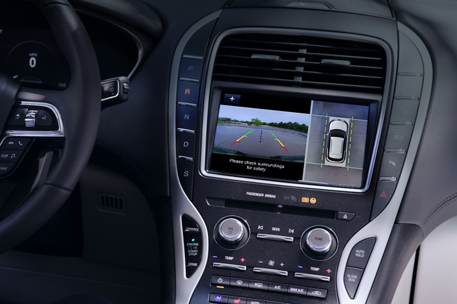 The center screen is shown while the rear view camera displays what is behind a 2020 Lincoln Black Label Nautilus