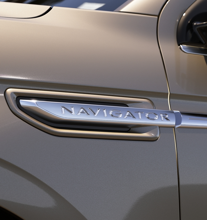 This is a close up image that shows off the chrome Navigator badge above the front wheel well