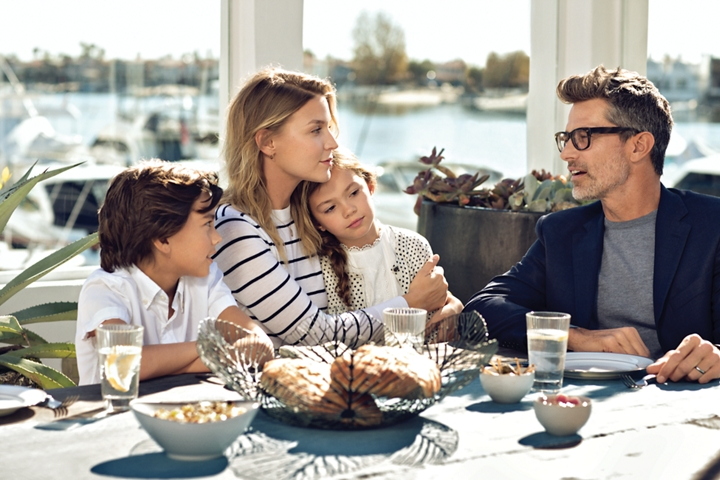 A family is shown enjoying a light breakfast in the dining room of a yacht club