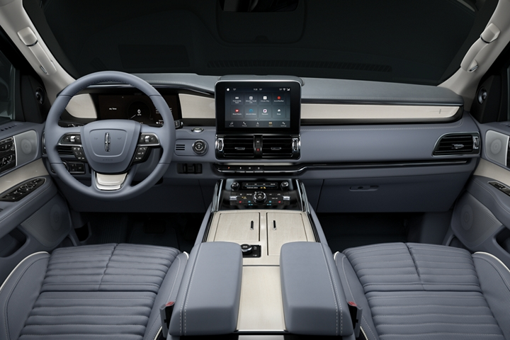 The driver and front passenger area of the Lincoln Black Label Navigator is shown from the perspective of the second row