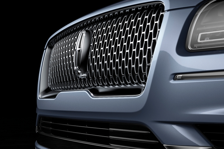 The bold and brilliant front grille of the Lincoln Black Label Navigator is shown in this image