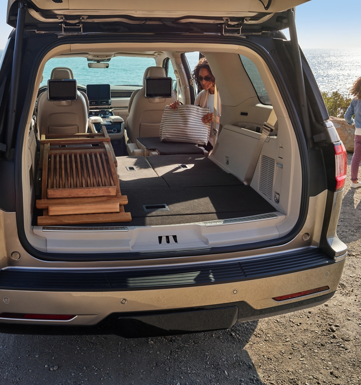 The second and third row of the Lincoln Navigator are shown folded flat demonstrating ample cargo space within