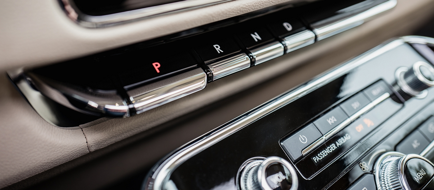 The piano key like shifting buttons are shown in the center console