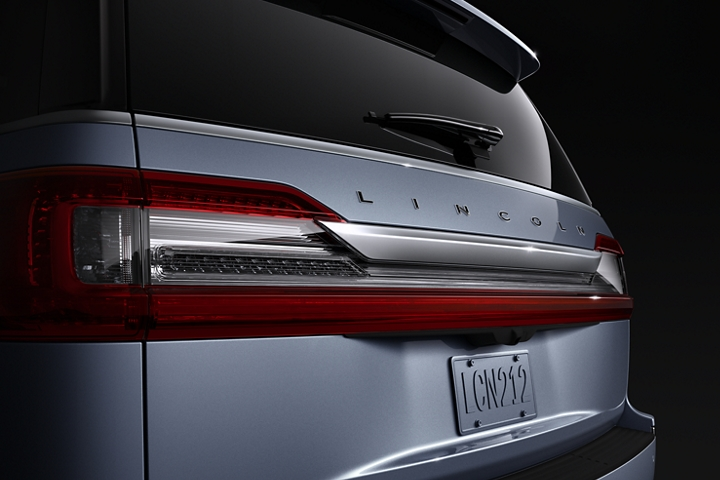 The rear of the 2020 Lincoln Black Label Navigator in the Chroma Crystal Blue features strong design lines