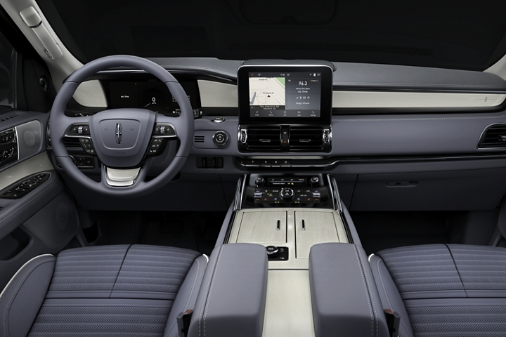 The driver and front passenger area of the 2020 Lincoln Black Label Navigator shows off sloping lines in the dash seats and other design elements
