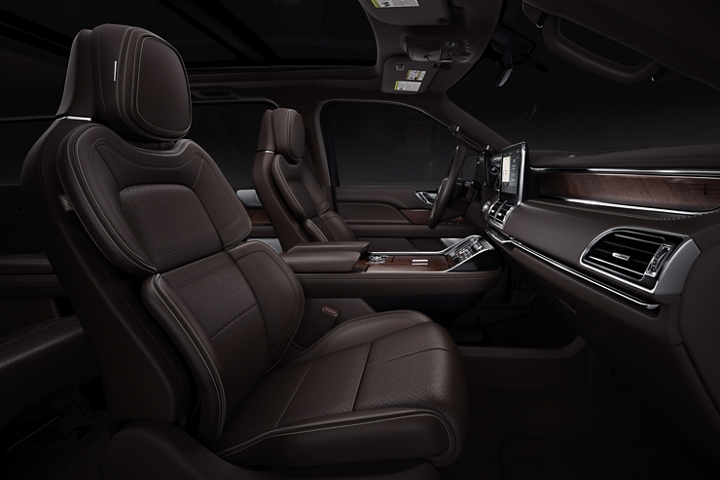 The interior of a 2020 Lincoln Black Label Destination Navigator shows off rich leather and wood in deep majestic tones