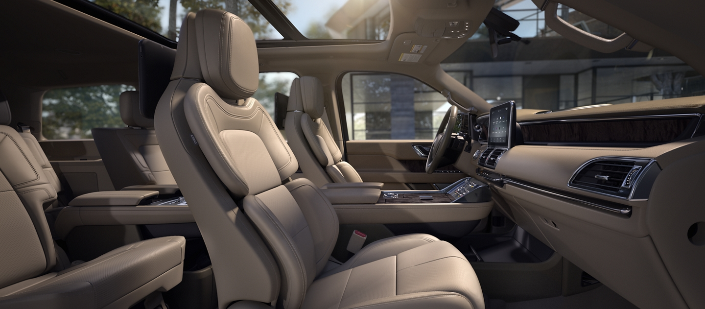 Sunshine bathes leather trimmed perfect position seats in a cappuccino interior and accentuates the comfortable curves of the seat form
