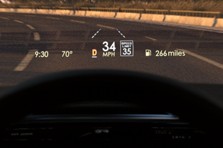 The bright Head Up Display projects vital information on the windshield above the steering wheel as a driver navigates a tropical drive at sunset